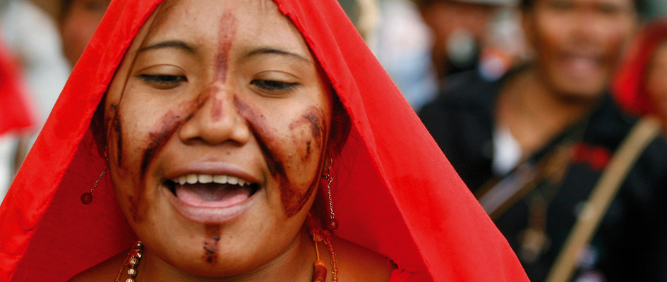 An indigenous Wayuu woman protests in Bogotá, Colombia. Her people are threatened with extinction by the actions of government, left-wing guerillas and multinational corporations. Humanitarian aid agencies, however, offer support and human rights training. Photo by John Vizcaino / Reuters.