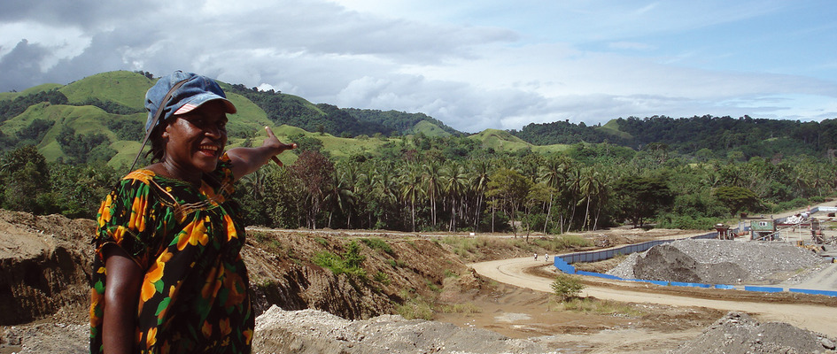 Ruth Kapi points to the devastation created by the Chinese-led Ramu Nickel mine project.