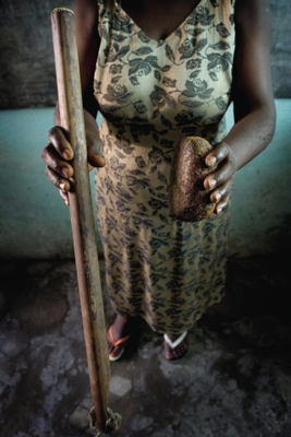 Stemming development: Tools used for breast ironing are often those found around the house and then heated. This mother holds a stone and pestle.