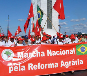 Marchers pass the Brazilian Congress in the capital Brasilia, May 2005.All photos by Gibby Zobel.
