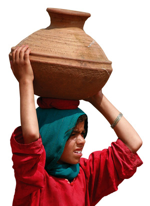 An internally displaced girl carries a pitcher of water in the Swat Valley.