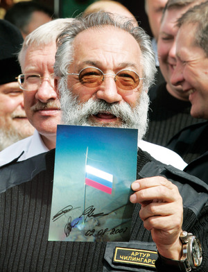 "Arctic explorer Artur Chilingarov shows a photograph of the Russian national flag that he planted on the seabed under the North Pole in August 2007. The provocative act, intended to stake a symbolic claim to the Arctic's mineral riches, didn't go down too well with Canadian Foreign Minister Peter MacKay. 'This isn't the 15th century,' he spluttered. 'You can't go around the world and just plant flags and say ""We're claiming this territory"".'"