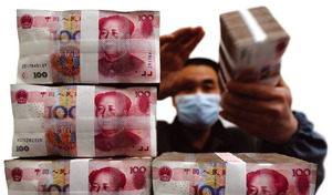 Stacking up the yuan: At the end of September 2008, the savings of Chinese people ($2.92 trillion) outstripped their loans almost 6 to 1.Reuters / Stringer in China