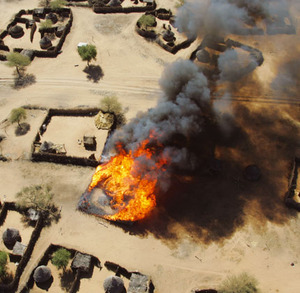 The burning of the village of Um Zeifa in Darfur after the Janjaweed looted and attacked it. The Chinese Government has supplied much of the munitions used by the Janjaweed to destroy the non-Arab peoples in the south of Sudan.