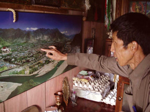 Exiled activist Jampa Tenzin points to his former home in Lhasa.