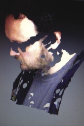 Chris 3D-scanned himself with a Kinect scanner, which can be found in X-box video games. Easy if you know how.