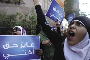 Women gather outside Cairo's State Council court to protest against virginity tests.