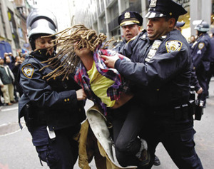 An Occupy Wall Street demonstrator is arrested by New York City police.