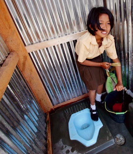 A girl in Java, Indonesia, enjoying her new school toilet.  Photo: UNICEF / Josh Estey