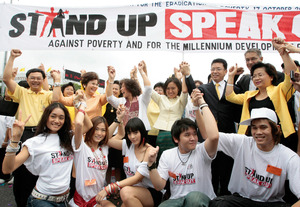 People join hands outside UN building in Bangkok to commemorate International Day for Eradication of Poverty.