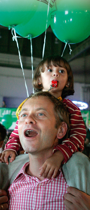 A supporter of Germany's Green Party reacts to first exit polls of German general elections in Berlin.