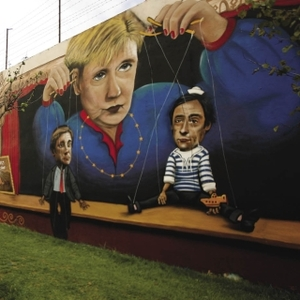 Merkel the puppeteer: a mural in Lisbon, Portugal, depicts the Portuguese Prime Minister and Foreign Minister as the German Chancellor's playthings.
