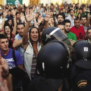 'Hands up! It's a robbery,' chant students and teachers at the police during a march in Malaga against the Spanish government's  educational spending cuts.Reuters/Jon Nazca