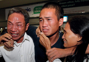 Pirates' victims are overwhelmingly seafarers from poor nations. Above, Vietnamese sailor Vu Van Ba is reunited with his parents after 18 months held hostage off the coast of Somalia.