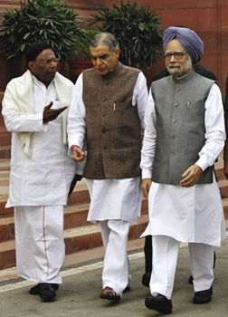 Under scrutiny: Prime Minister Manmohan Singh (right) and Parliamentary Affairs Minister Pawan Kumar Bansal.B Mathur/Reuters