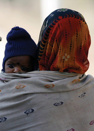 A New Delhi construction worker holds her baby close.Desmond Boylan/Reuters