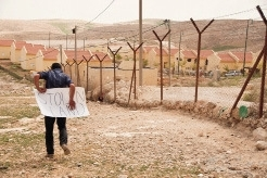 A boy protests illegal settlements near Hebron.Gary Wlash