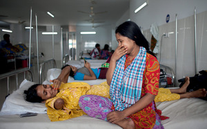 Mariam, Rana Plaza survivor, shares a joke with her sister in Dhaka last June.Suvra Kanti Das