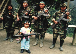 A stolen childhood: for those recruited into the FARC's rebel army, returning to civilian life is a new challenge. This photo of a young girl holding a weapon was found on the body of a rebel killed in combat in 2008.