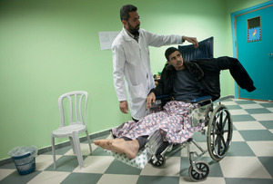 Jamal Salman receives treatment at Al-Wafa Rehabilitation Centre in Gaza. He was injured during an Israeli drone strike which killed his wife and brother-in-law. The father of two small children, he is now paraplegic and has limited use of one of his arms.Anne Paq/Activestills