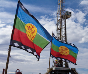 Mapuche flags flutter in front of YPF's wells in Campo Maripe, Argentina, during a blockade in August by the Mapuche community.Emiliano Ortiz/8300web