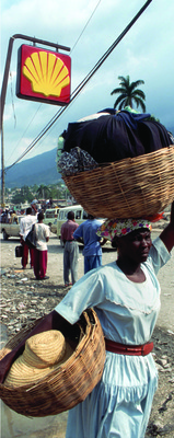 A street vendor in Port-au- Prince.  Most Haitians are still waiting for reconstruction  to begin.