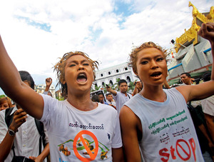 Demonstrators jostle in the streets of Rangoon, Burma, to protest the expansion of the Chinese-backed Latpadaung copper mine in the country's northwest province. Thousands of hectares of farmland have been expropriated by the company and hundreds of villagers forced from their homes.