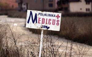 A signpost for the clinic that was the hub for criminal activity.Photo: Visar Kryeziu/AP/Press Association Images