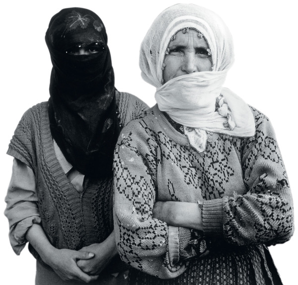 Denied a voice: Kurds such as these women, who fled their village when it was attacked by the Turkish army, have long faced linguistic, as well as cultural, oppression.
