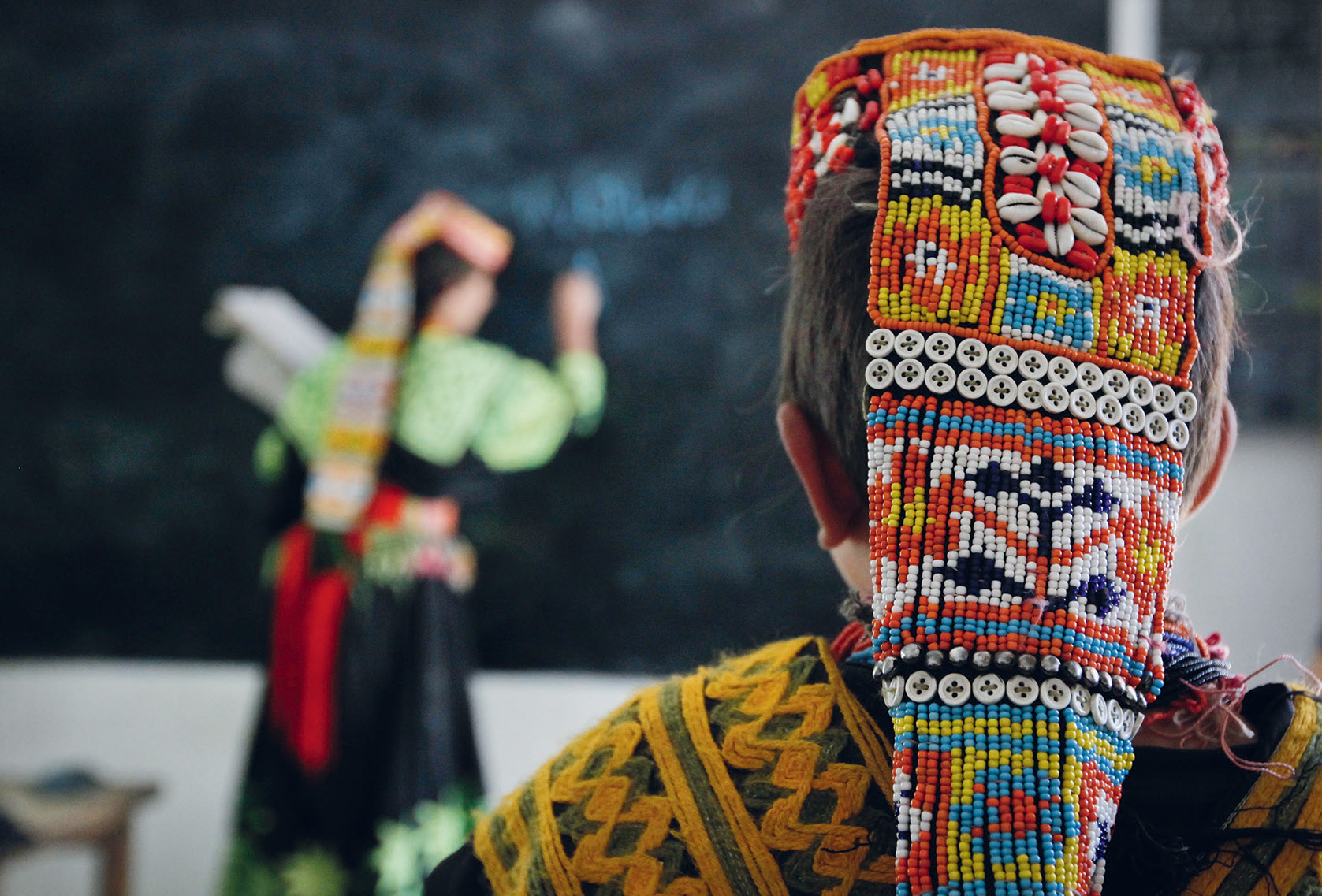 Keeping the language alive: just 3,500 of Pakistan's 180 million people speak Kalasha, here being taught at a school in Brun village. It is believed to be the closest modern language to Ancient Sanskrit.