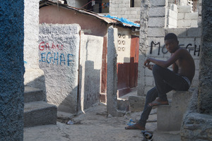A youngster sits outside the headquarters of the Movement for Liberty and Equality of Haitians for Brotherhood (MOLEGHAF) in Fort National, Port-au-Prince. The grassroots group has been vocal in its criticism of the country's UN mission.