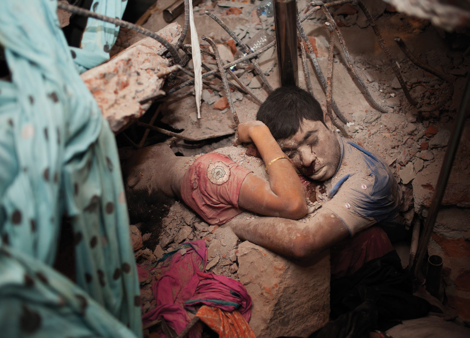 'This image, while deeply disturbing, is also hauntingly beautiful. An embrace in death, its tenderness rises above the rubble to touch us where we are most vulnerable. By making it personal, it refuses to let go. This is a photograph that will torment us in our dreams. Quietly it tells us: never again.' Taslima Akhter, a former student and current teacher at Pathshala. A labour activist, Taslima has been involved with the garments movement for many years.