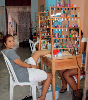 One of Cuba's half a million new entrepreneurs at work in her front room in Old Havana.Vanessa Baird