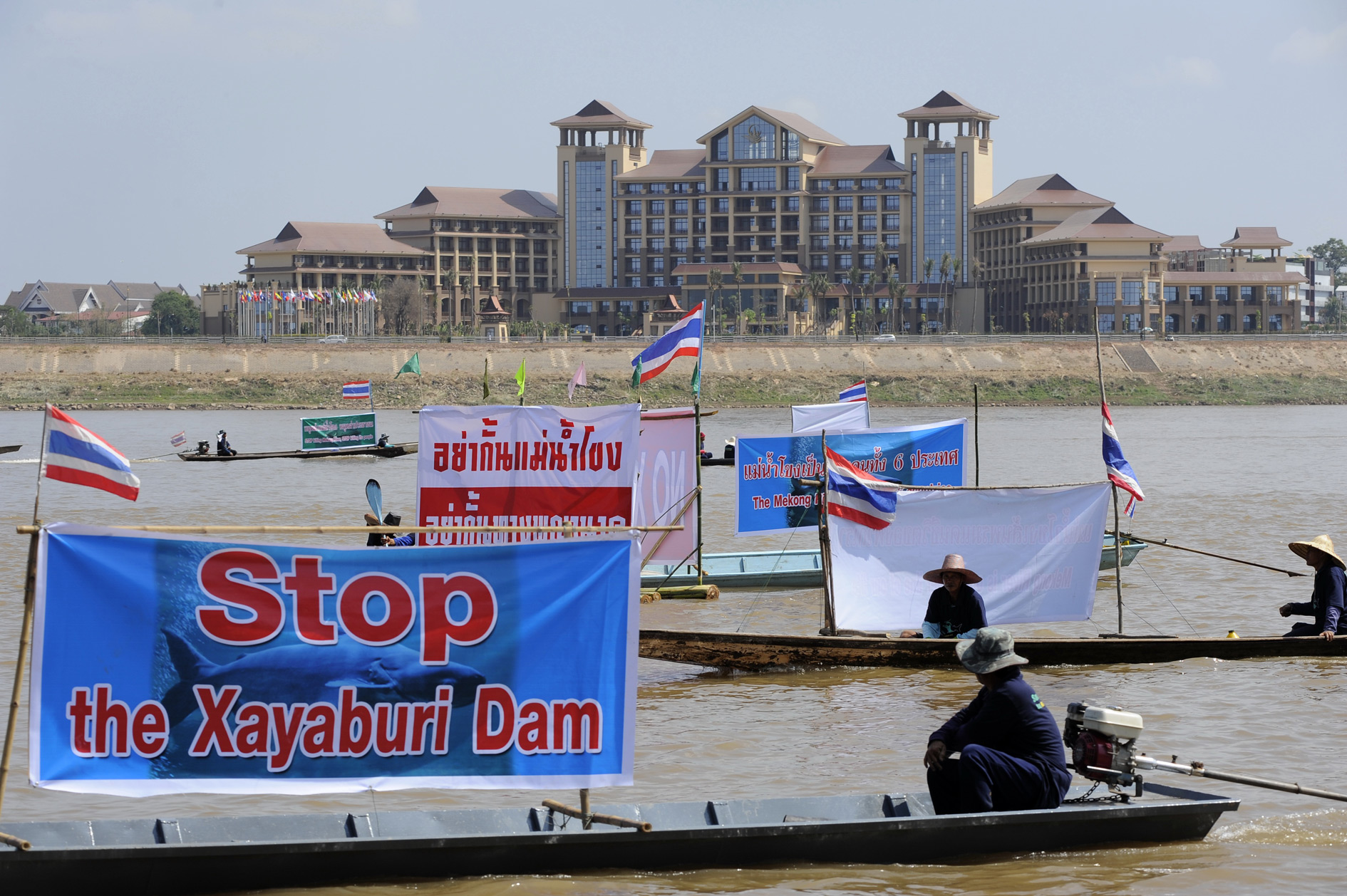 Thai NGOs stage a boat protest on the Mekong River in Laos. The convention centre on the opposite bank was hosting a major international conference.