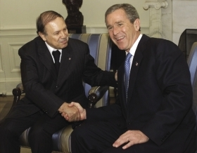 So happy together: Algeria's then president Abdelaziz Bouteflika with George W Bush in 2001.Win McNamee / Reuters