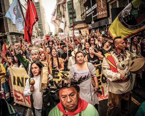 Leave the oil in the soil! Indigenous representatives from communities resisting oil extraction all over the world marched together at the front of the recent 400,000-strong New York climate march. Photo: Jenna Pope / Bold Nebraska