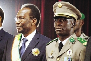 Halos of power: Malian coup leader Captain Amadou Sanogo (right) with interim president Dioncounda Traoré in April 2012.