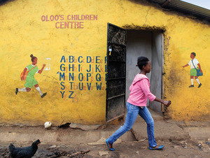 Not today: a girl walks past a school in Kibera, a nairobi slum without running water or electricity, where 800 aid organizations operate.Noor Khamis / Reuters