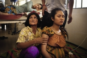 A worker recovers in hospital after fainting at a factory run by Sabrina Garment Manufacturing Corporation, a Nike supplier.