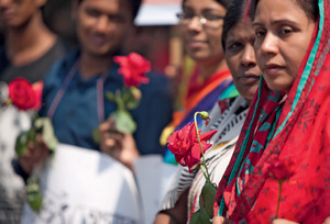 Mourners remember Avijit Roy, murdered in March. Just weeks later, Washiqur Rahman, a blogger known for his atheist views, was also killed in Dhaka.ZUMA Press, Inc. / Alamy