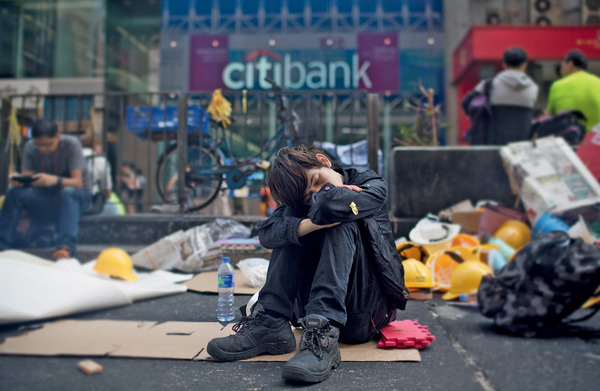 Under the influence: a protester makes his feelings felt during demonstrations in Hong Kong, October 2014. Photo: Getty/Bloomberg/Brent Lewin