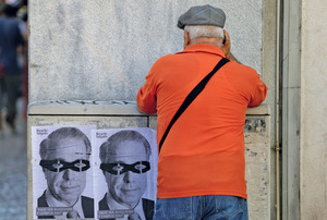 Robber banking baron: Ricardo Salgado, former chief executive of collapsed Banco Espirito Santo. The poster in Lisbon, Portugal, says: 'It's hard to be a banker these days.'Francisco Seco/AP/Press Association Images