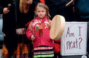 A girl attends a rally to remember missing and murdered indigenous women in Vancouver's Downtown Eastside on Valentine's Day, 2015.