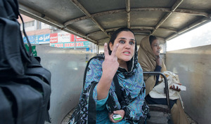 Flashing a victory sign, Sana Ijaz (above) demonstrates the fighting spirit of Pakistani civil society, after being arrested for demanding the government do more to counter the Pakistani Taliban.Photo: AP Photo/Mohammad Sajjad