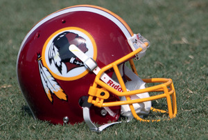 Racially offensive names and images (as on this Washington Redskins helmet) should be kicked into touch.