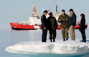 Canada's Prime Minister Stephen Harper (second right), here talking to Chief of Defence Staff Walt Natynczyk, is keen to defend the country's frozen assets.Photo: Chris Wattie/Reuters