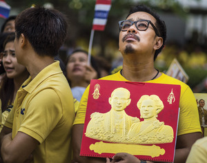 Supporters of the King gathered outside his hospital when he was admitted last December. The monarchy, still revered by many, is considered beyond reproach.