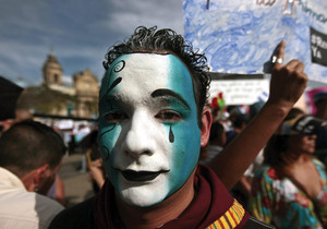 Crying out for change: a protester at an anti-corruption demonstration in Guatemala City. Photo: Esteban Biba/Alamy