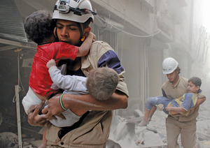 Members of the White Helmets rescue children in Aleppo after an air strike by the Syrian armed forces, June 2014.