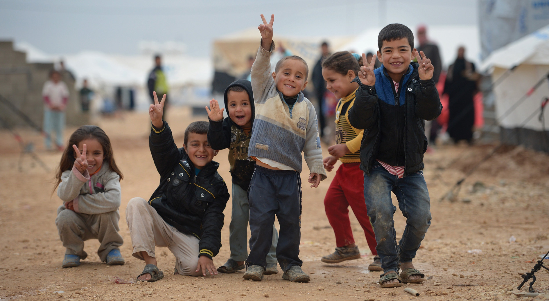 Children pose for a picture in the Za'atari refugee camp in Jordan.